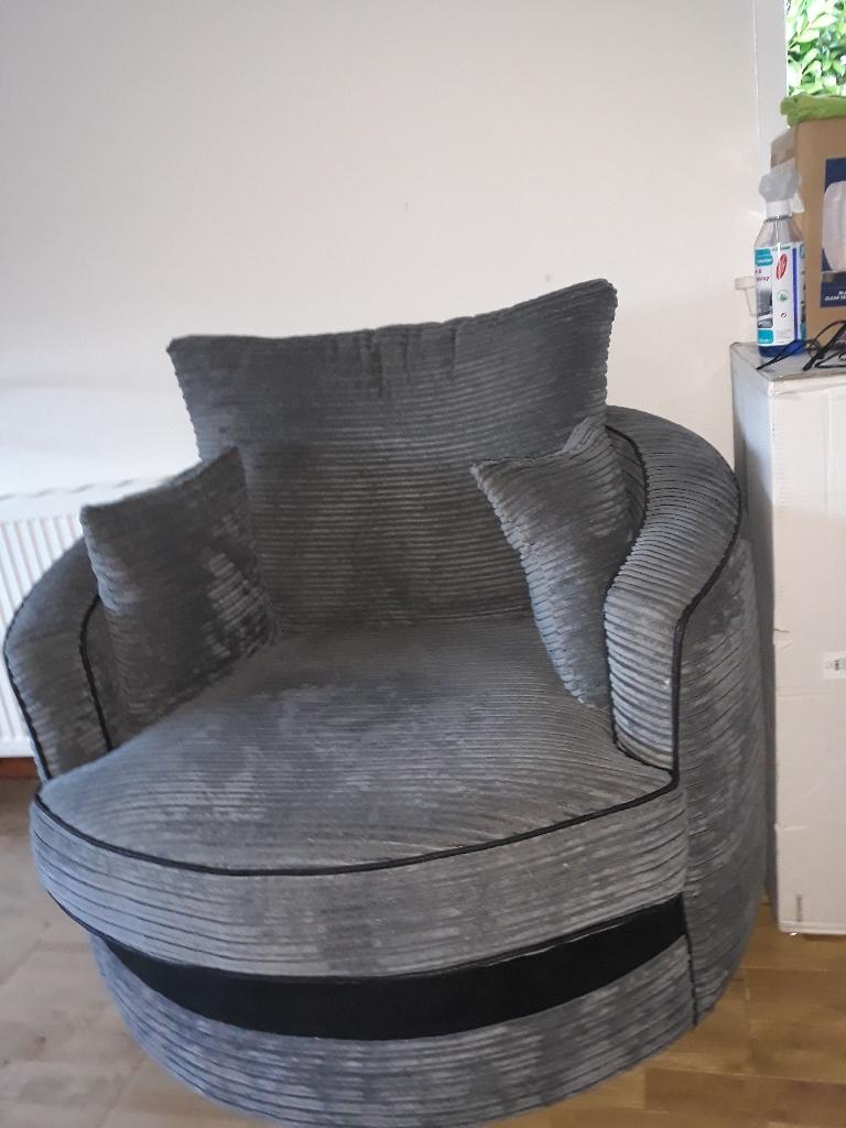 Grey ribbed swivel cuddle/love seat