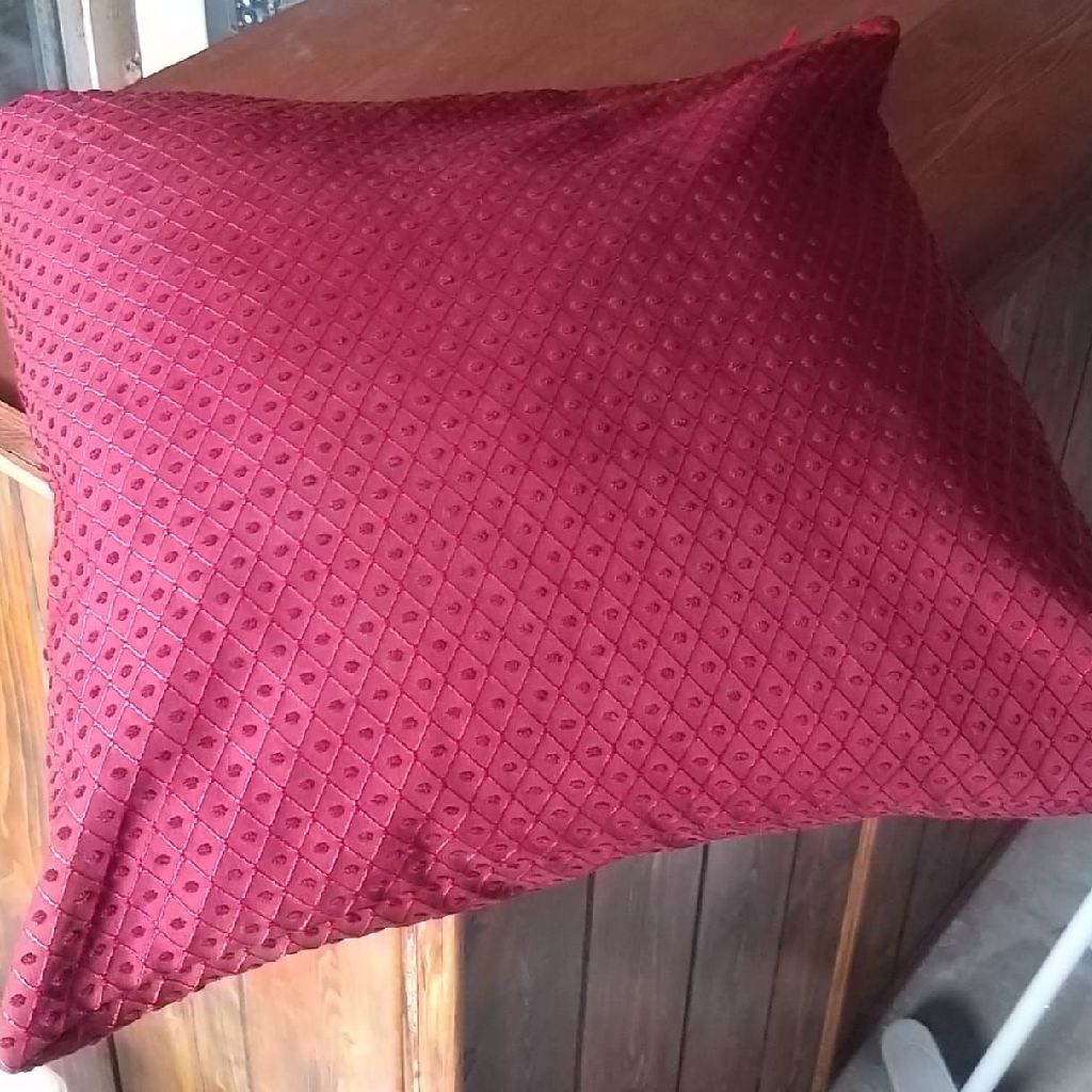 Large red cushion
