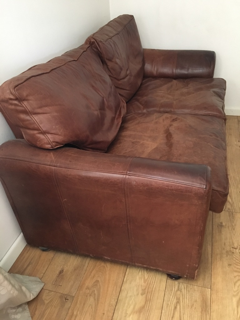 2 old leather sofas