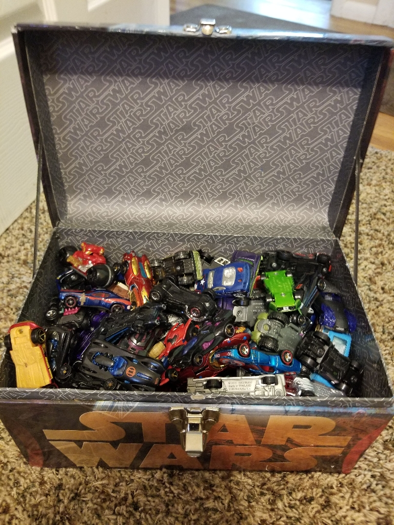 Star Wars toy chest filled with 87 different toy vehicles.