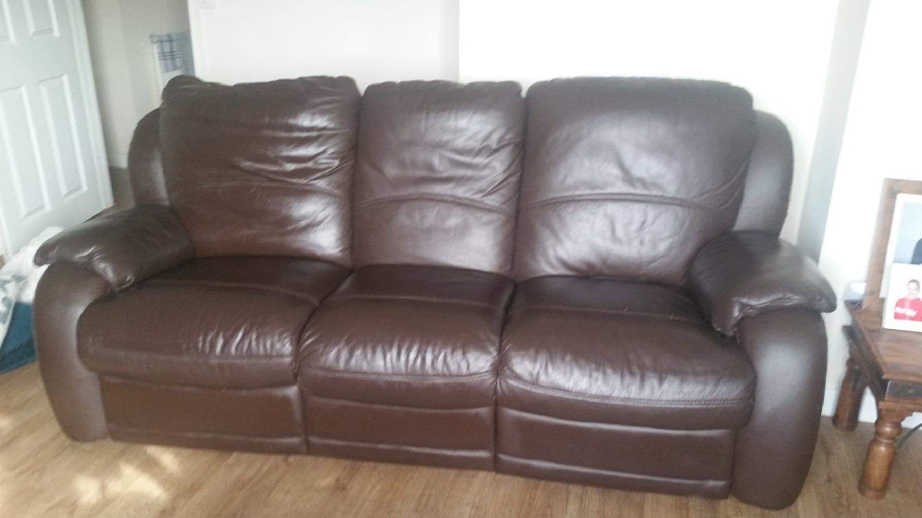3 seater and 1 chair both reclining dark real brown leather