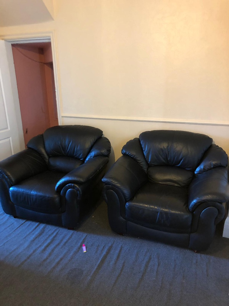 Larger black leather 3 seater and 2 chairs