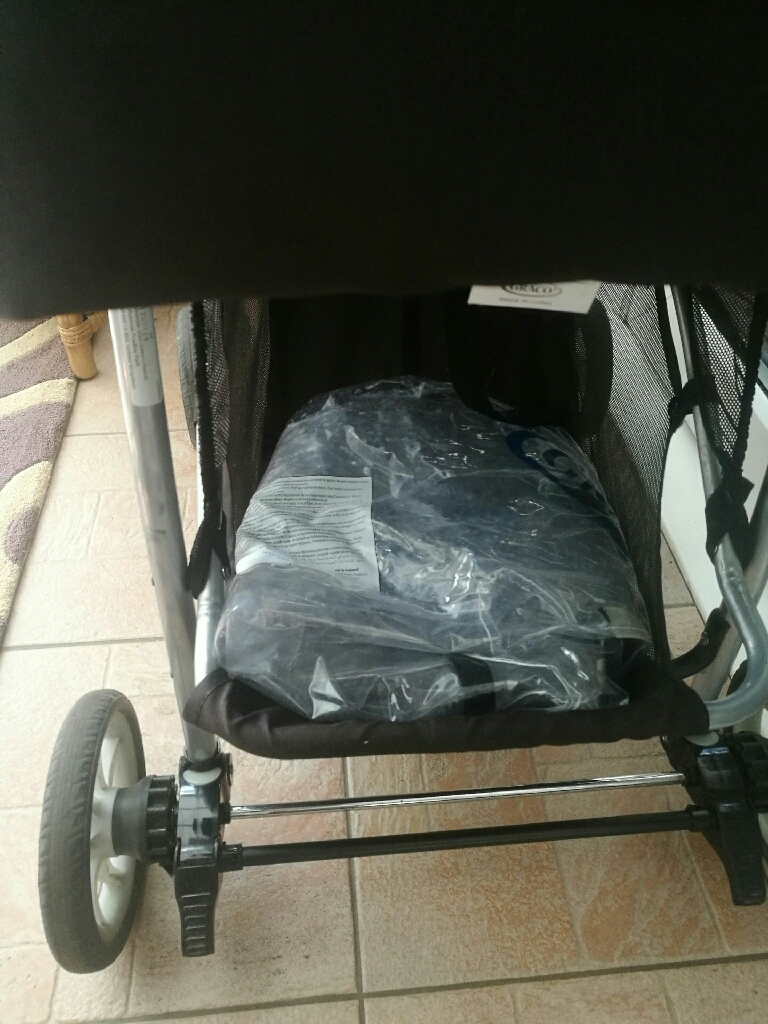 Graco travel system with rain wear