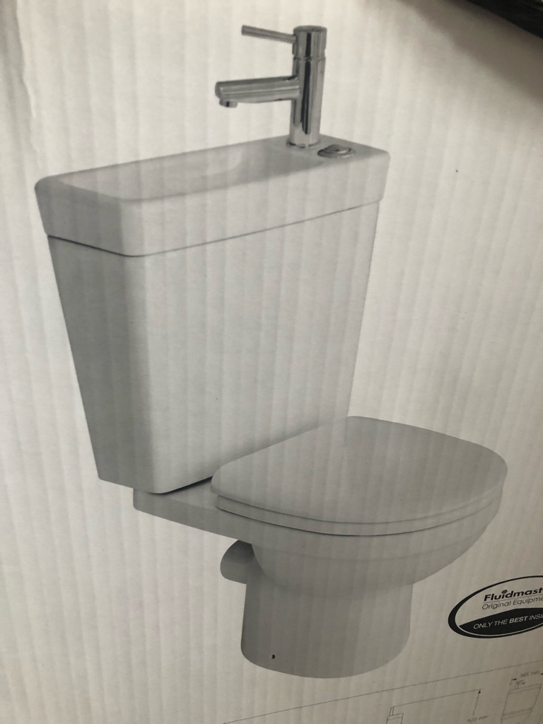 Brand new 2 in 1 Toilet and Sink. Still in unopened box