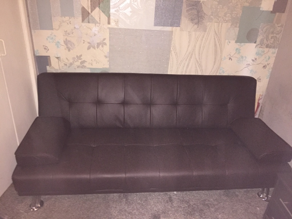 Faux brown leather sofa bed