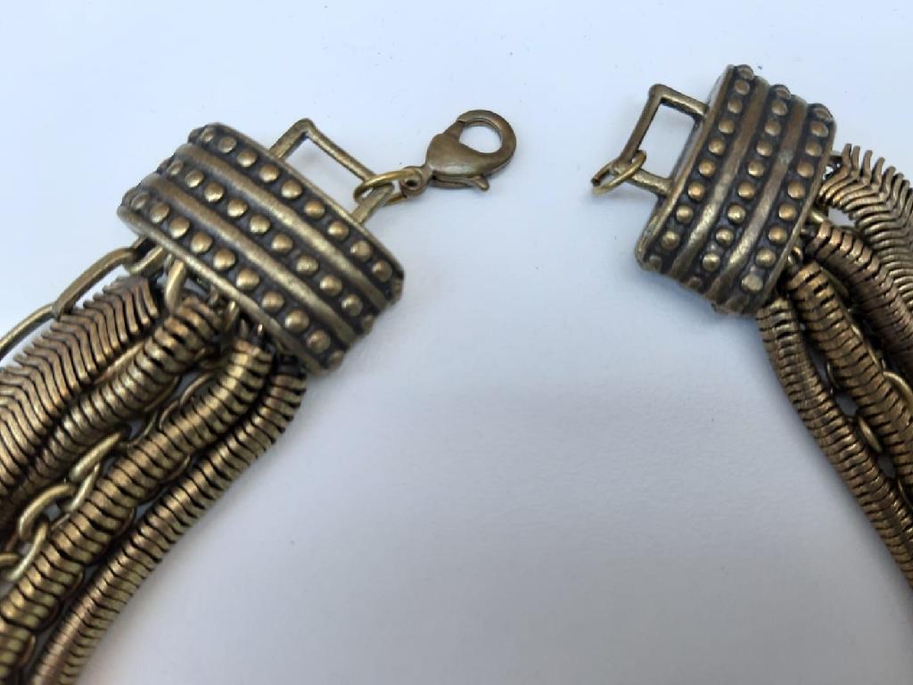 Striking dark gold-coloured necklace & bracelet set.