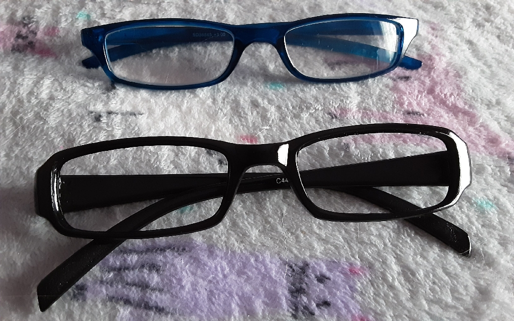 GLASSES X 2, ONE BLACK PAIR NO LENS, 1 ELECTRIC BLUE PAIR WITH LENS