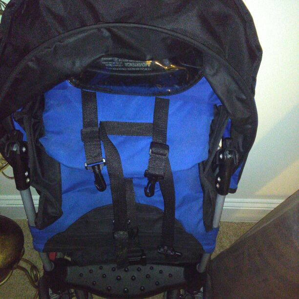 Blue and black Jeep stroller