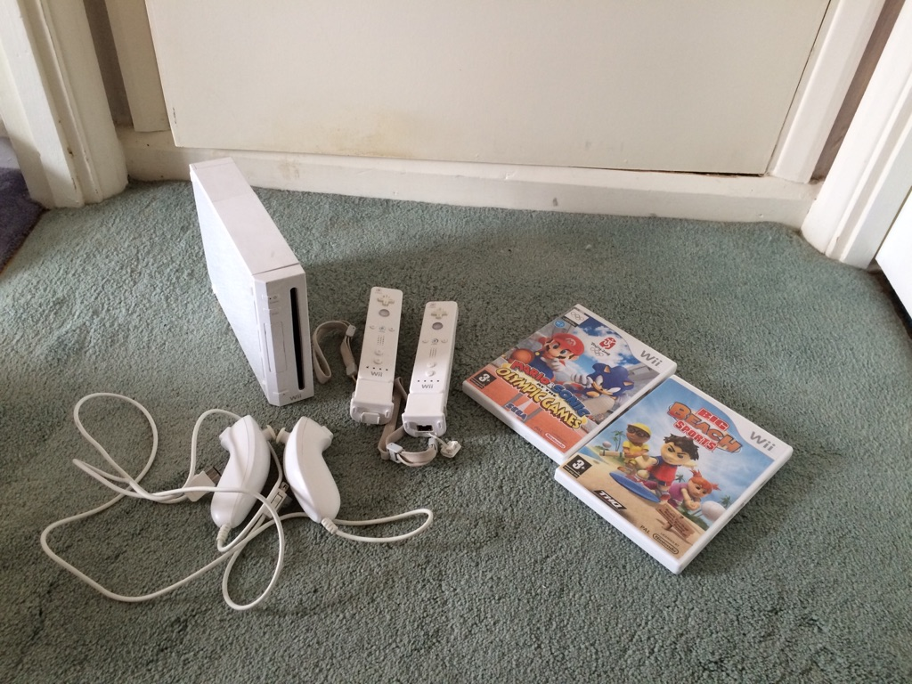 Nitendo wii and remotes with games
