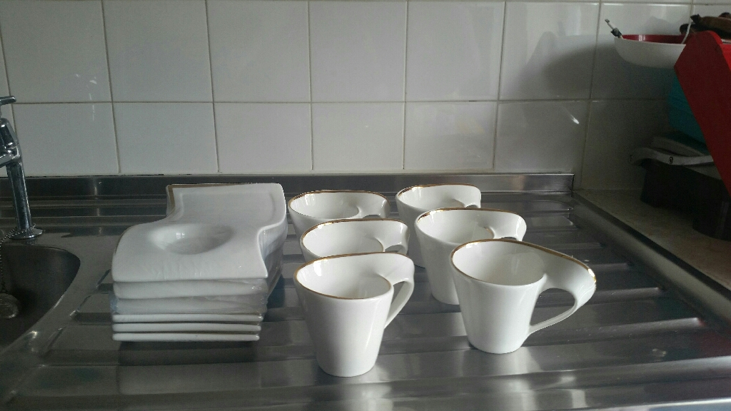Coffee cup and holder