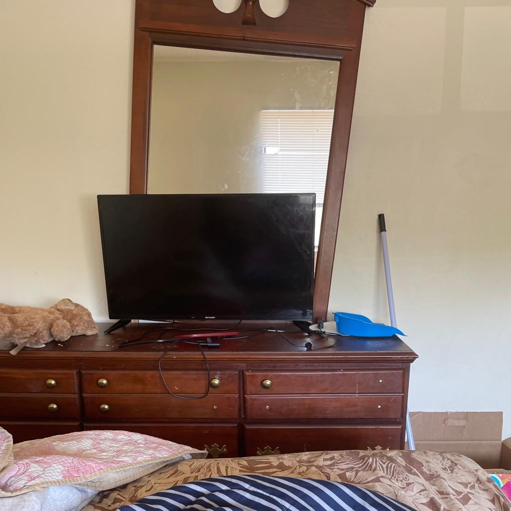 Brown dresser with mirror