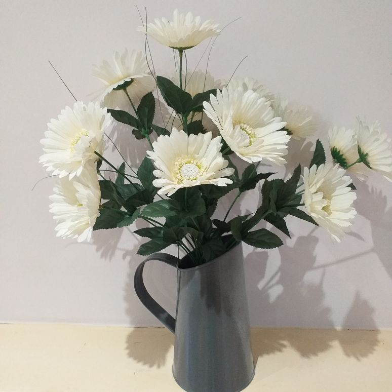 Metal grey jug with silk cream gerbera
