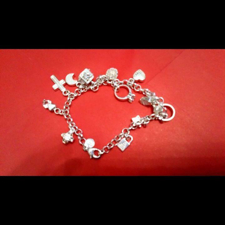 Genuine silver charm bracelet