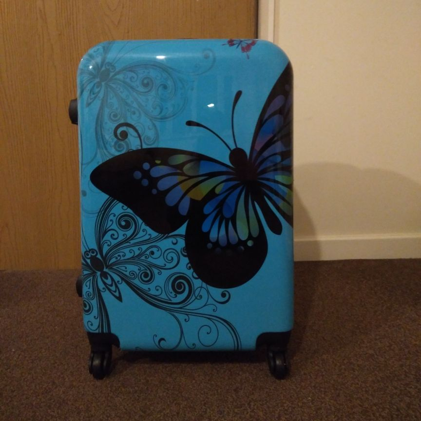 Blue butterfly suitcase with padlock