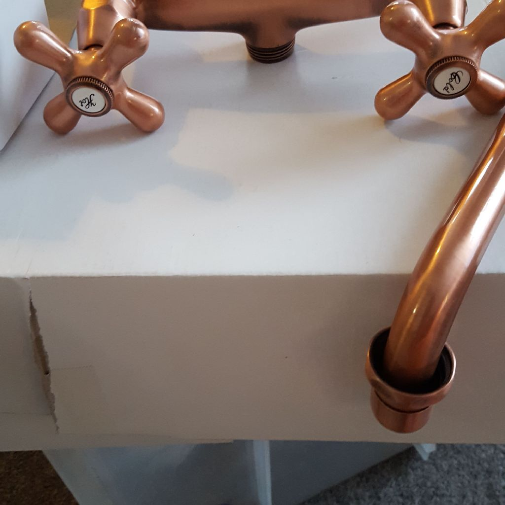 Copper wall mounted mixer taps