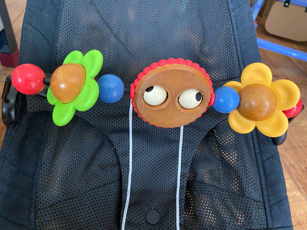 Baby Bjorn bouncer with Googly eyes toy bar