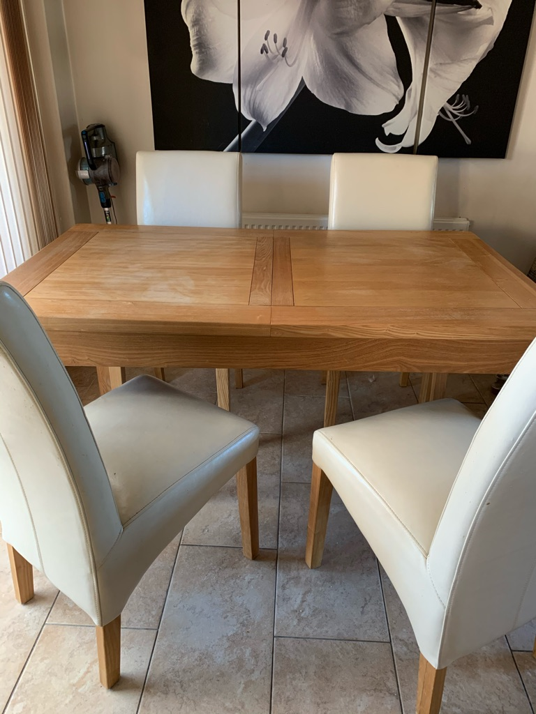 Extending wood dining table and chairs