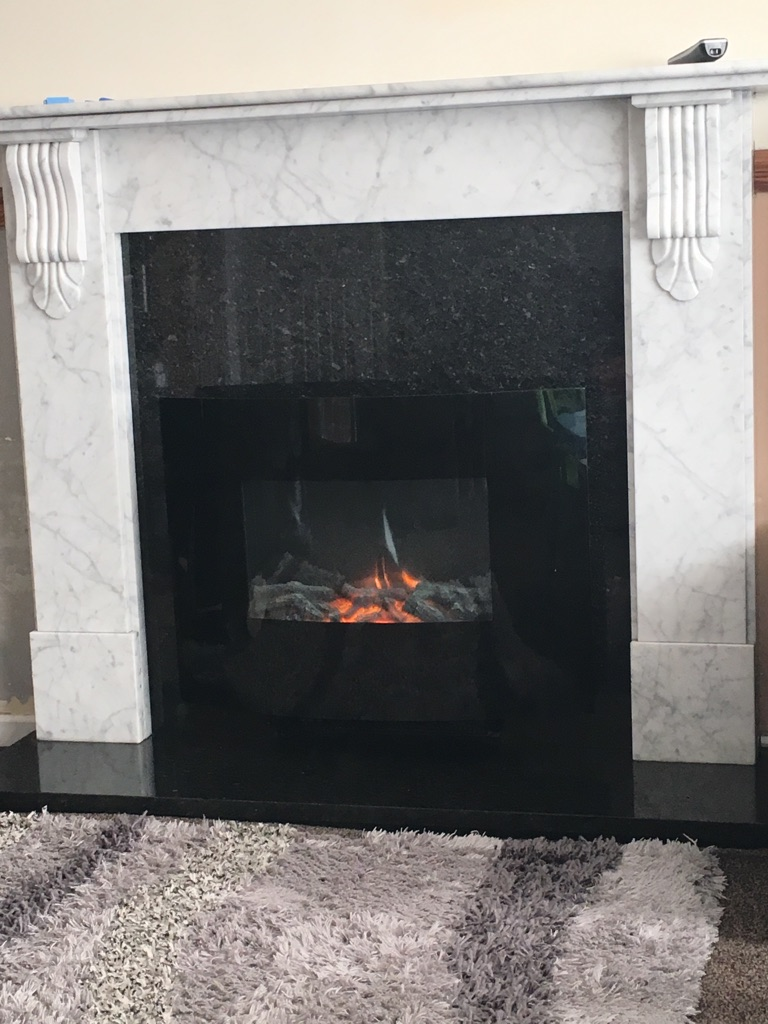 Stunning Marble Fireplace harth and electric fire