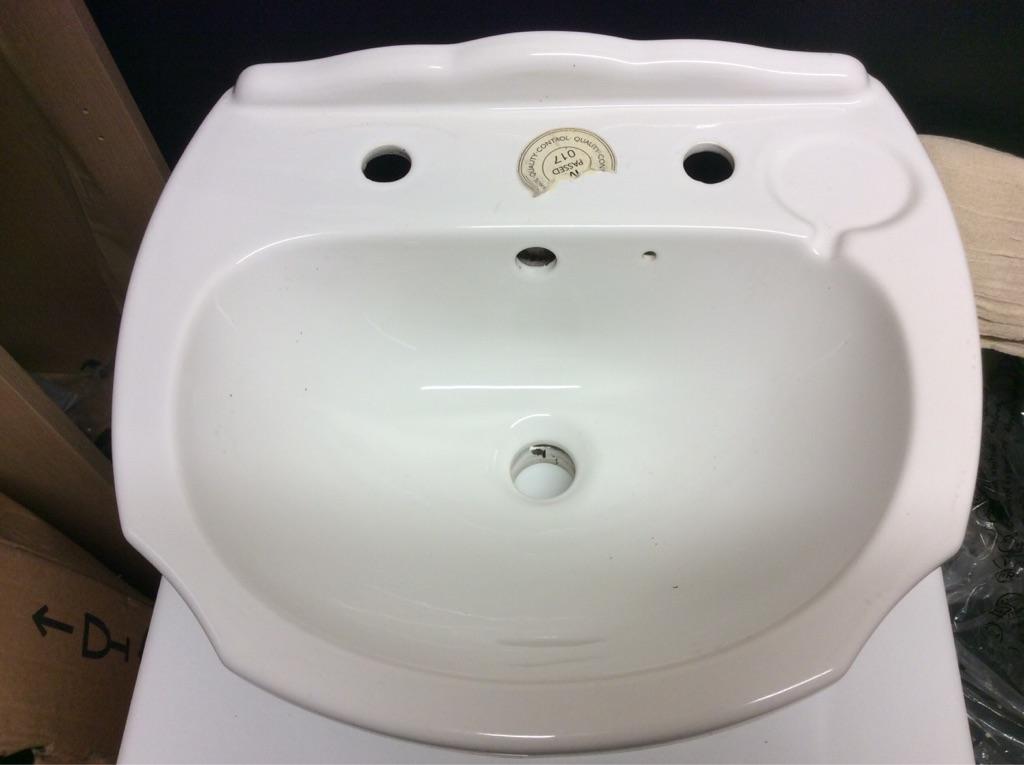 Ceramic inset vanity basin