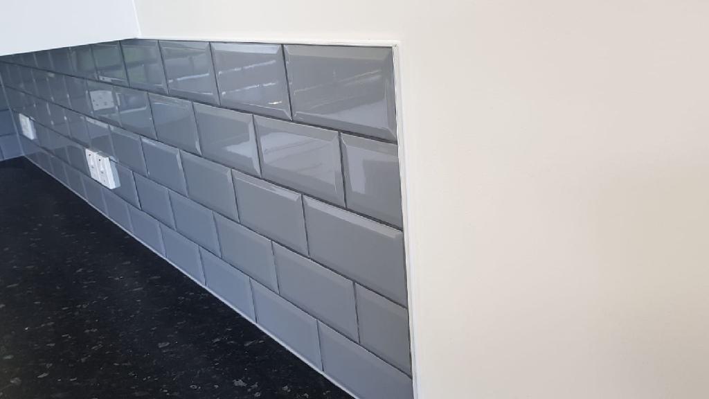 Tiles, adhesive and trim