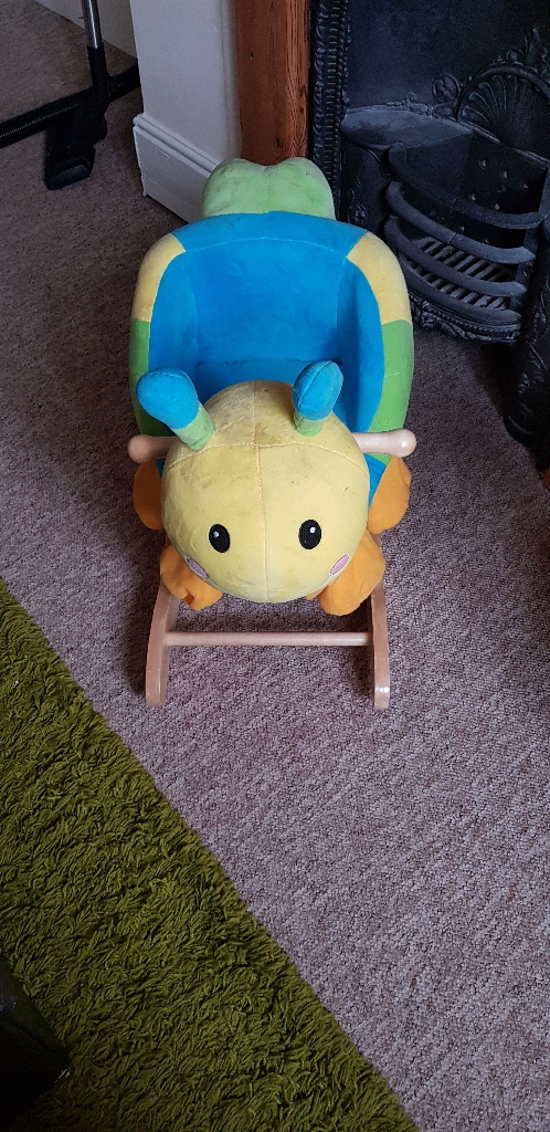 Rocking caterpillar £10 wooden walker£10 Moses basket and stand £15 carry sling £5