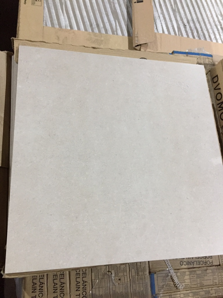 Limestone effect porcelain wall and floor tile 456x456mm - £3 each tile.