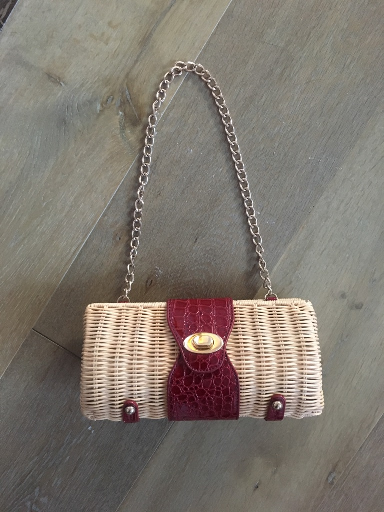 women's white and red leather shoulderbag