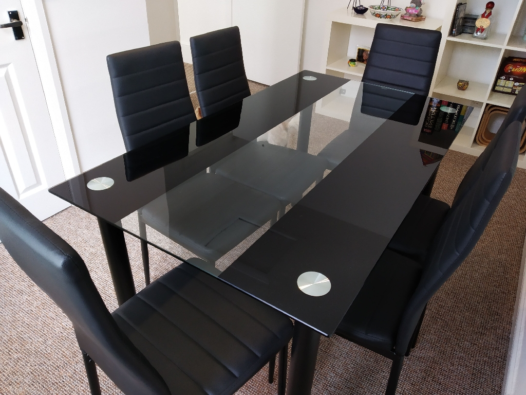 Glass black and white table and 6 faux leather chairs