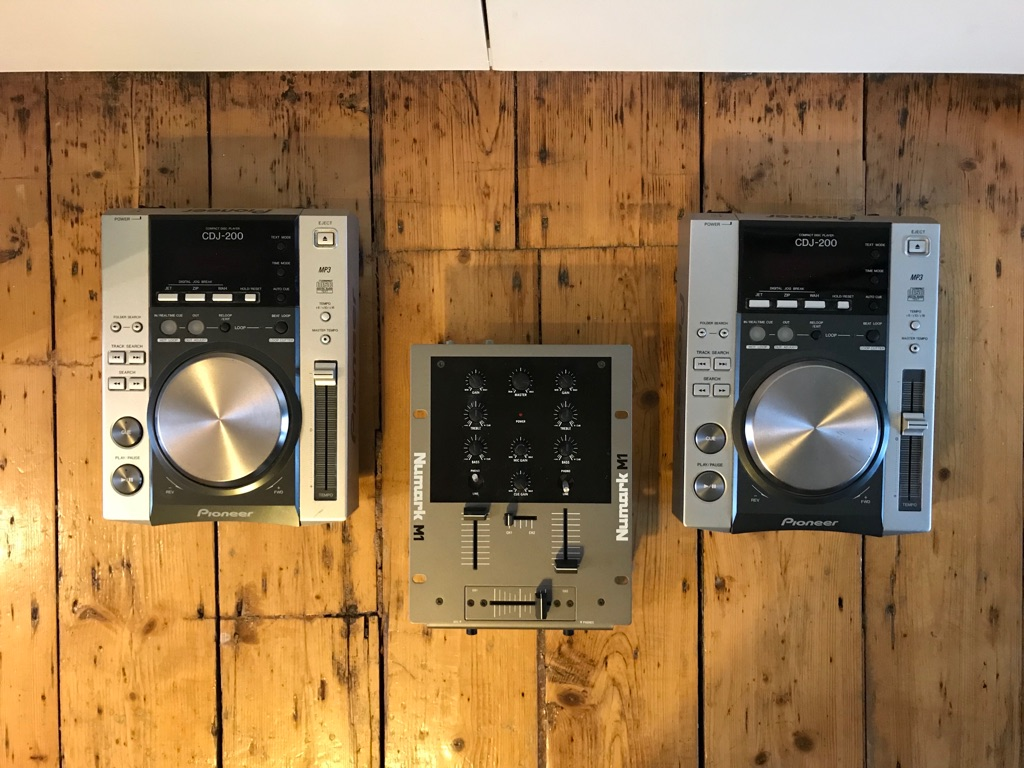 Two Pioneer CDJ 200s and one Numark M1 Mixer + cables