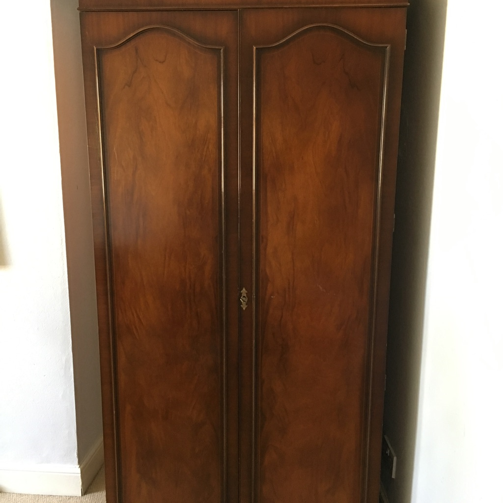 Spacious vintage dark wooden wardrobe with pretty key lock detail