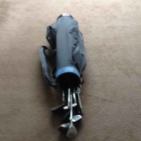 Golf clubs plus bag and umbrella