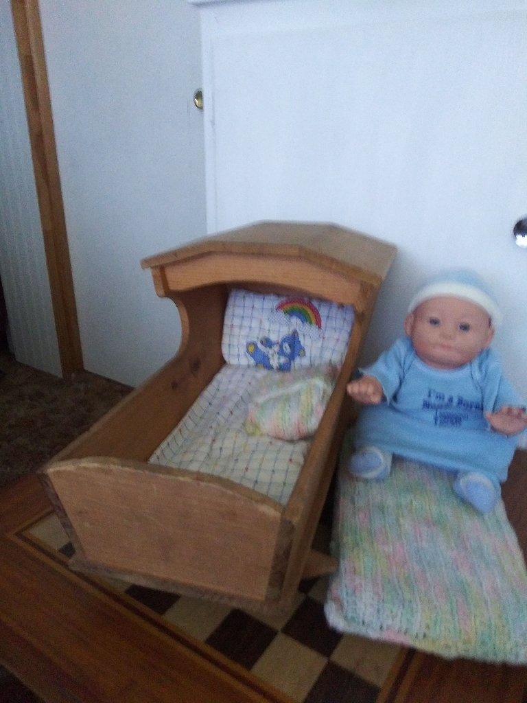 Handmade wooden dolls cradle