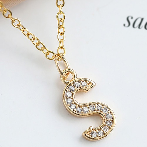 Gold crystal 'S' pendant necklace