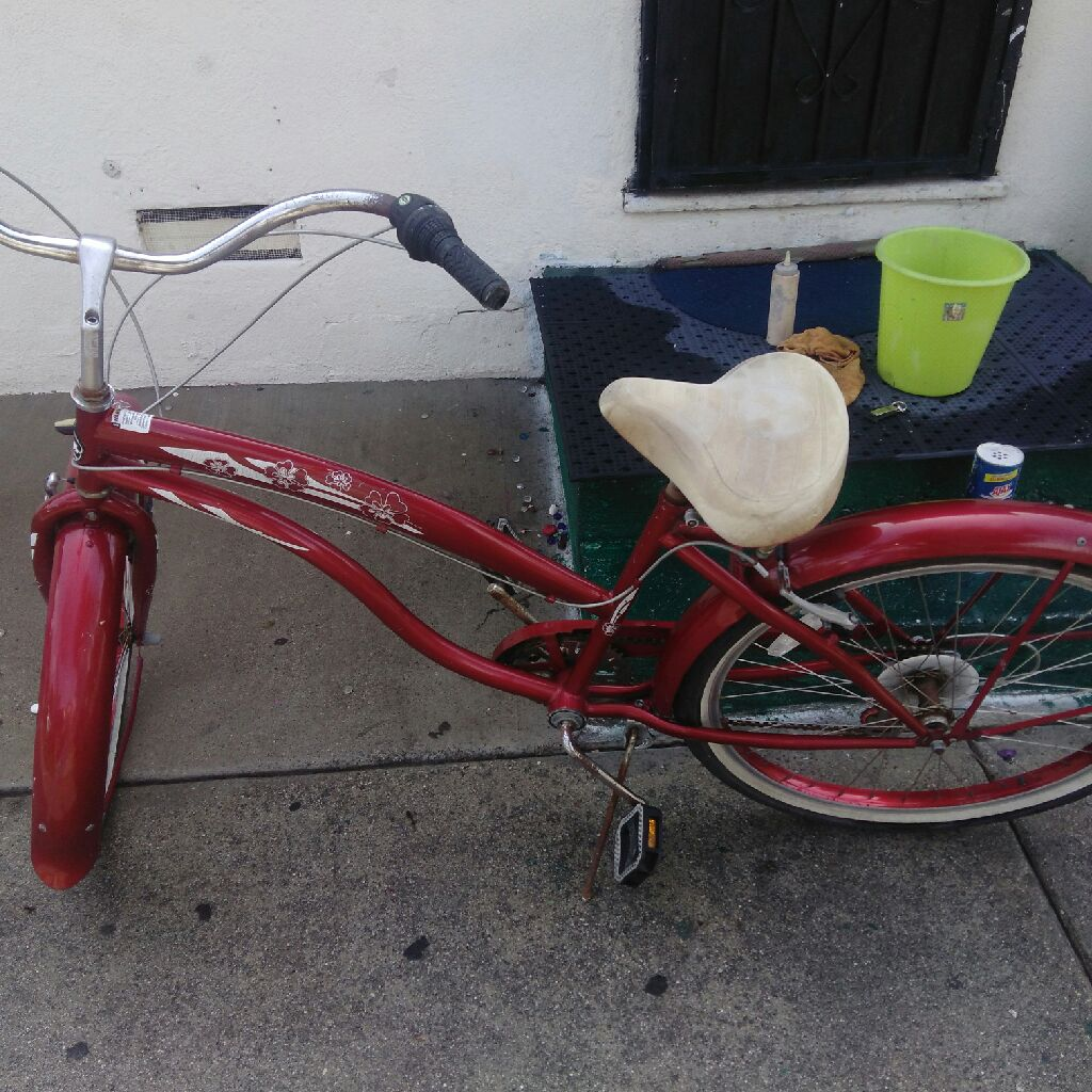Ladys red bike