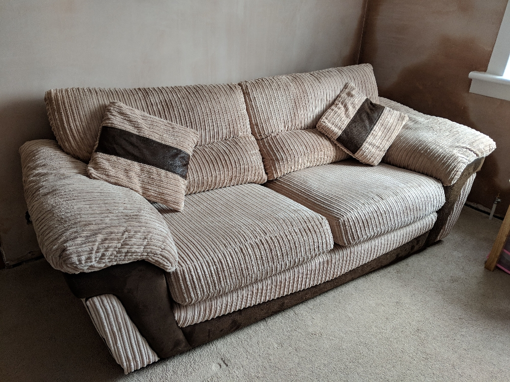 Large 3 seater sofa, 2 seater sofa, pouffe and 4 cushions.