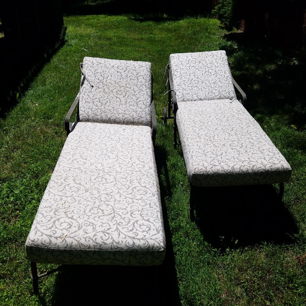 Two matching wrought iron Loungers