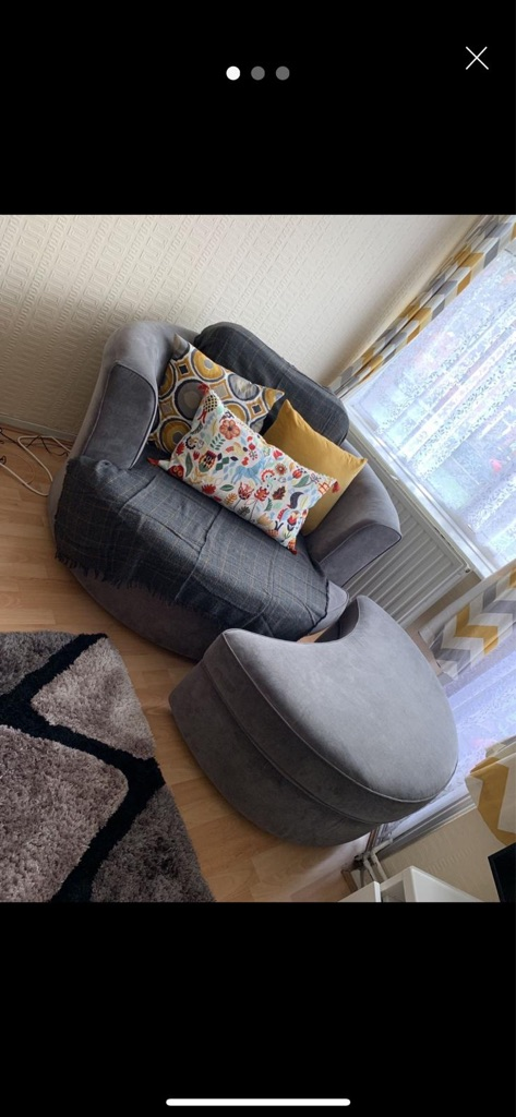 DFS grey swivel chair