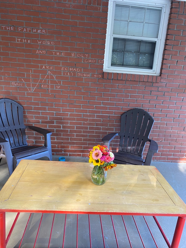 1 recliner 2 outdoor brown chairs (plastic) and a table wooden seat