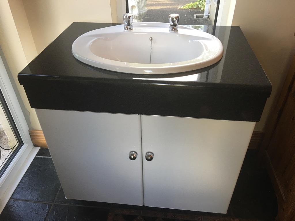 Bathroom vanity sink basin storage unit
