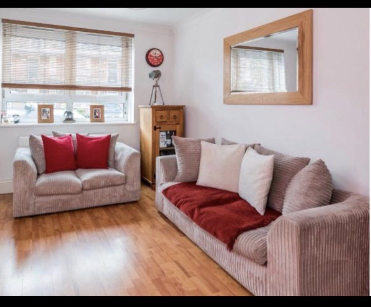 Matching two seater and three seater cord sofa set