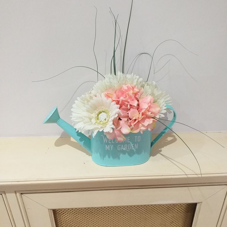 Watering can with selection of silk flowers