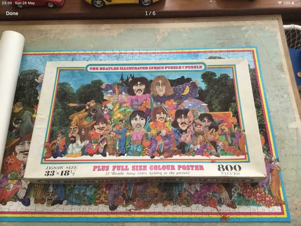 The Beatles illustrated lurics puzzle in a puzzle 800 pieces complete very rare 33in 18in plus full size colour poster puzzle in sealed bag inside sheet of paper to show the songs very good condition 1970