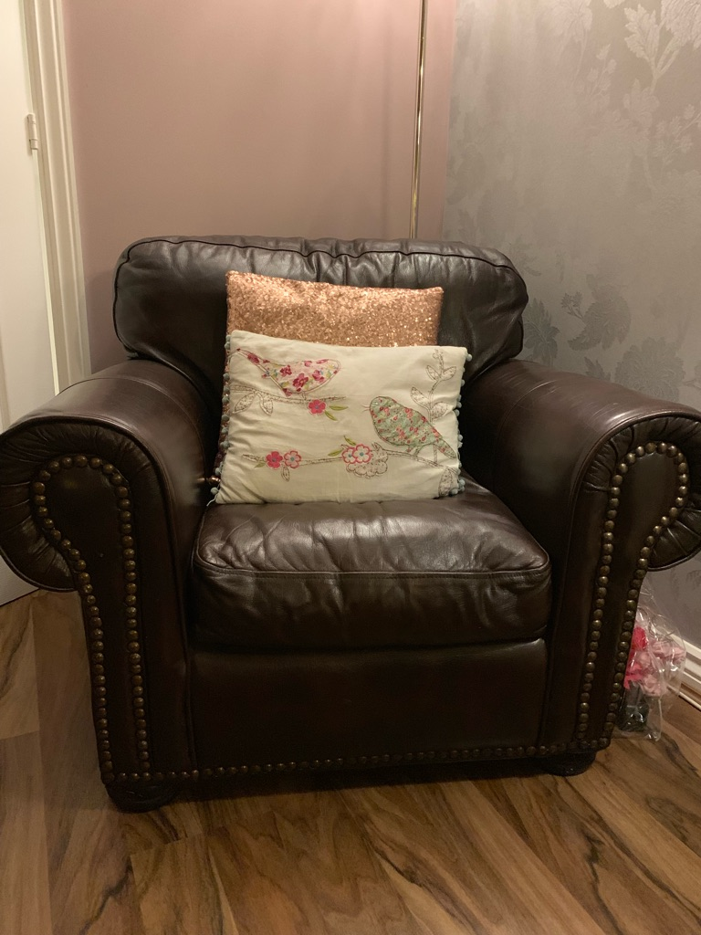 Dark Brown faux leather armchair