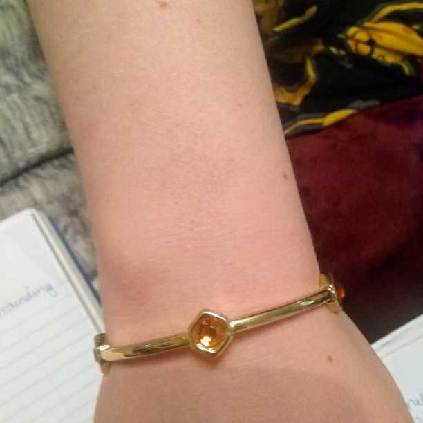 Gold bracelet with burnished brown jewels