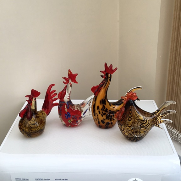 Four glass chickens