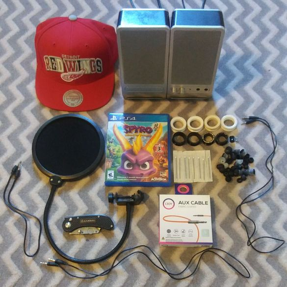 PS4 GAME, POCKET KNIFE, SNAPBACK, EARBUDS + MORE