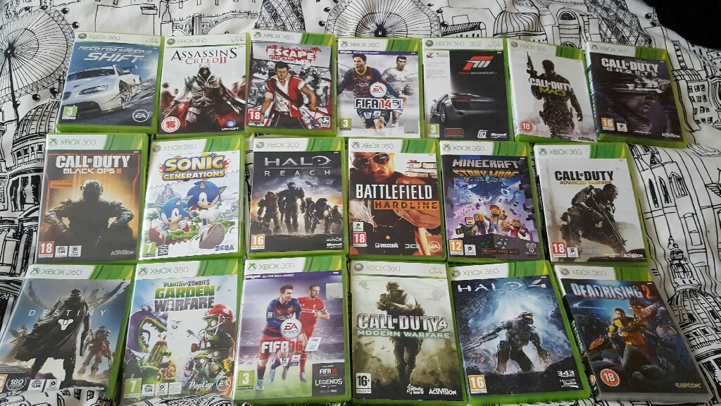 Xbox 360 with charging station and 19 games
