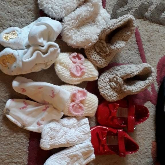 Bundle of pram shoes and mittens