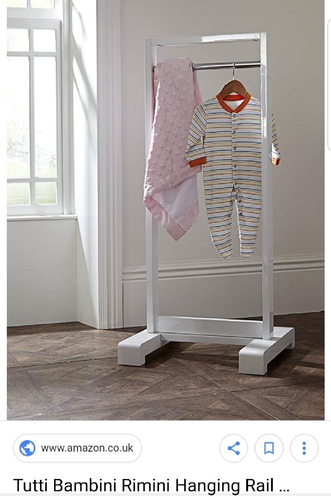 White gloss clothes rail