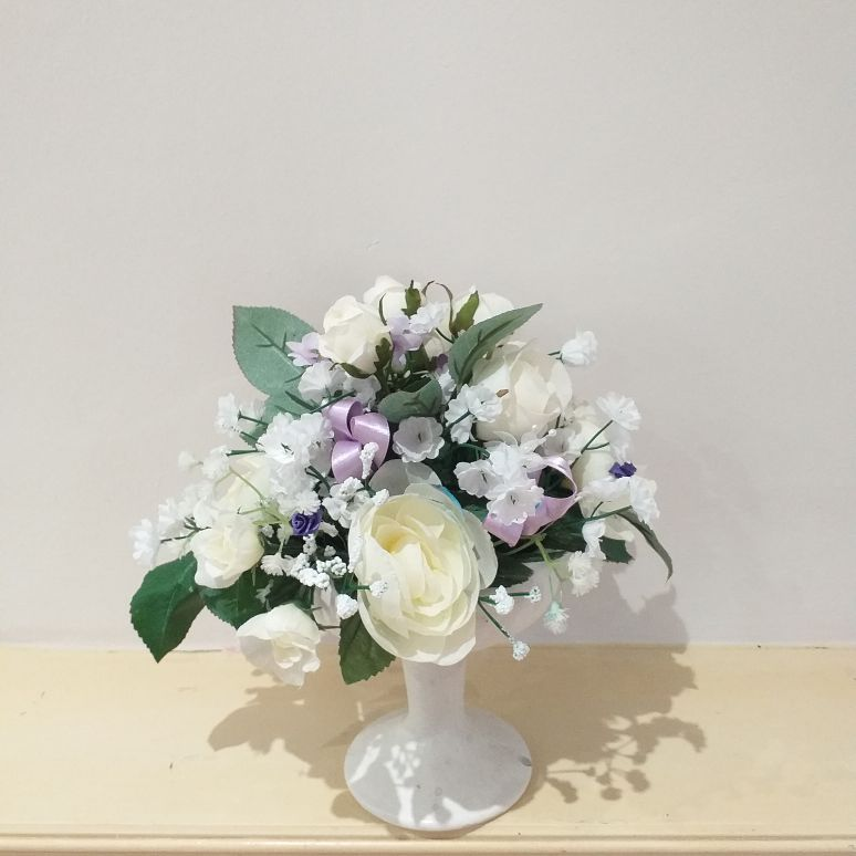 Lilac and cream arrangement in ceramic cream vase